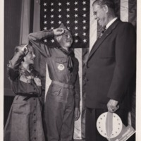 1951 (circa) - Boy Scout and Girl Scout Saluting Edwin Dalstrom [Dalstrom].tif